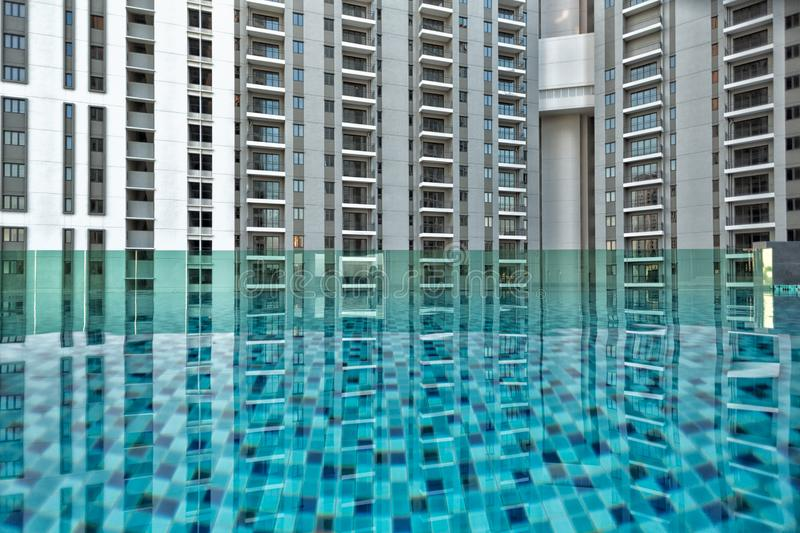 Detail of new residential apartment block, not yet occupied, with swimming pool in foreground. In George Town on Penang Island, Malaysia royalty free stock images