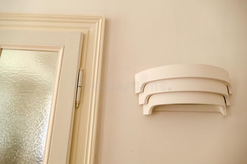 Detail od curve lighting on the wall royalty free stock photography