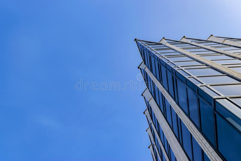 Detail of office building exterior. Business buildings skyline looking up with blue sky. Modern architecture apartment. High tech stock images