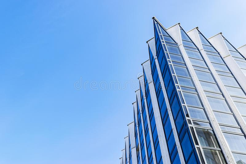 Detail of office building exterior. Business buildings skyline looking up with blue sky. Modern architecture apartment. High tech. Exterior. Reflective stock photography