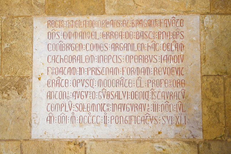 Detail in the Old Cathedral of Coimbra, Portugal. Plaque in remembrance of Queen Amelie of Orleans, last queen of Portugal, in the Cloister of the Old Cathedral royalty free stock photo