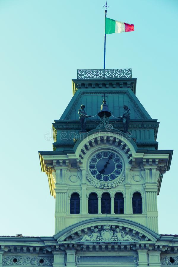 Detail of old clock and bell tower from Town Hall Building in Trieste, Italy. View from Square of Italian Unity. Vintage processing stock image