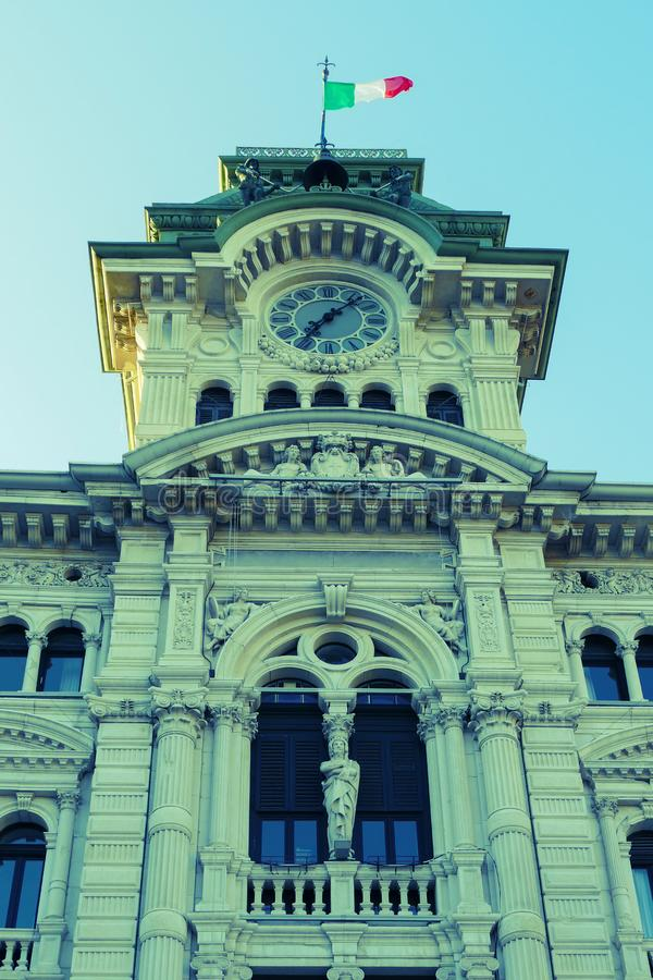 Detail of old clock and bell tower from Town Hall Building in Trieste, Italy. View from Square of Italian Unity. Vintage processing stock images