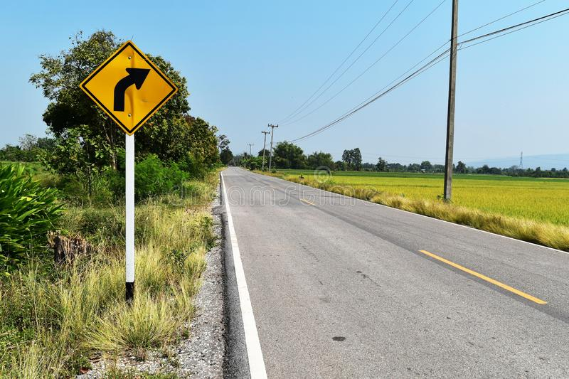 Old and dirty traffic signs beside asphalt road in countryside stock images