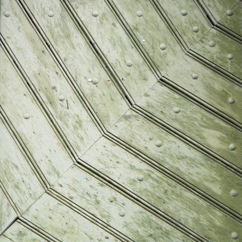 Detail of old green door texture stock photo
