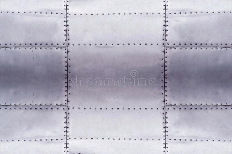 Detail of old grunge piece of metal plate with bolts. Aluminum surface background stock images