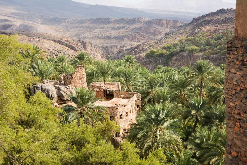 An old house in the village of Misfat al Abriyyin between date palms and the valley in the background. Detail of an old house in the village of Misfat al royalty free stock photography