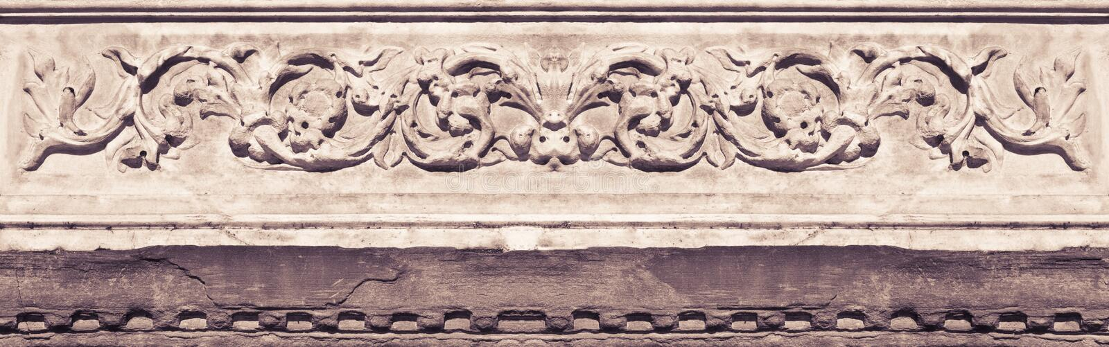 Detail of an old Italian molding stone eaves with foliage and pl royalty free stock photography