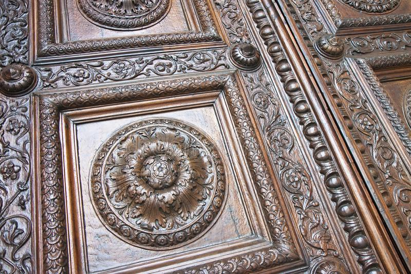Detail of an old italian wooden carved door with floral decorations - Cathedral of St. Martin Italy-Tuscany-Lucca city stock photo