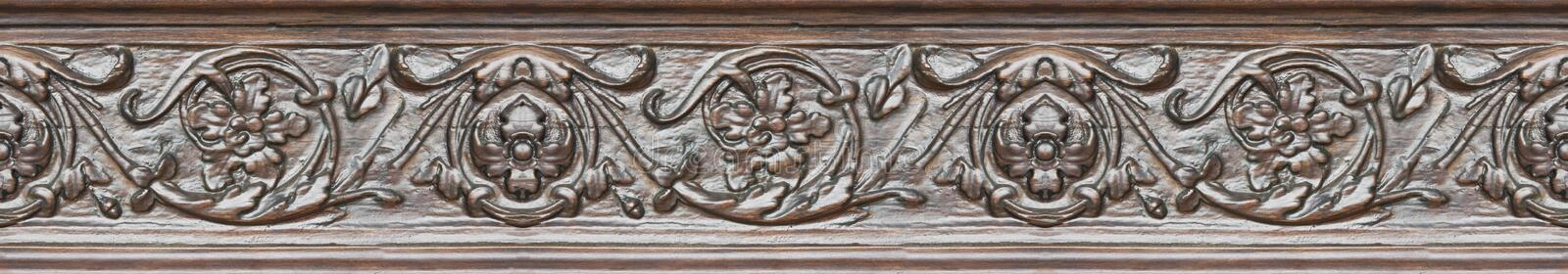 Detail of an old italian wooden carved frame with floral decorations - semless pattern.  royalty free stock photos