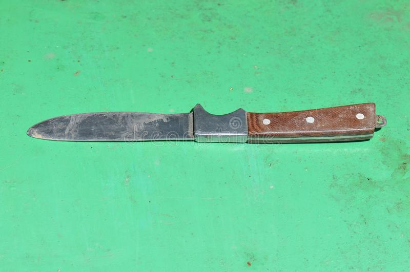 An old knife with wooden handle stock photo