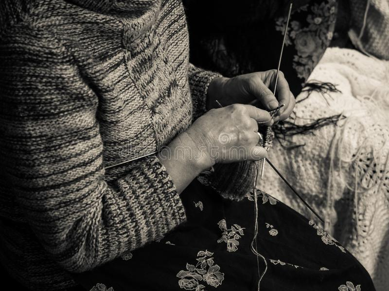 Detail of an old lady knitting stock image