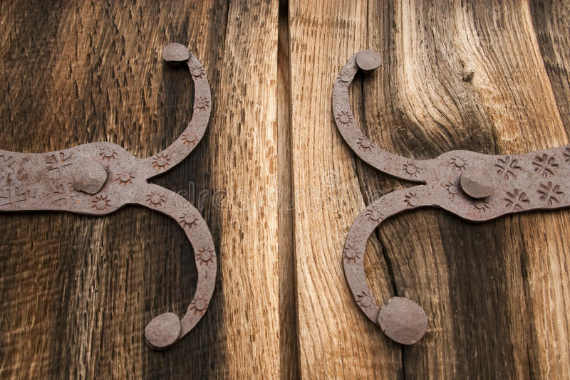 Detail of old oak wood gate with metal decoration royalty free stock images