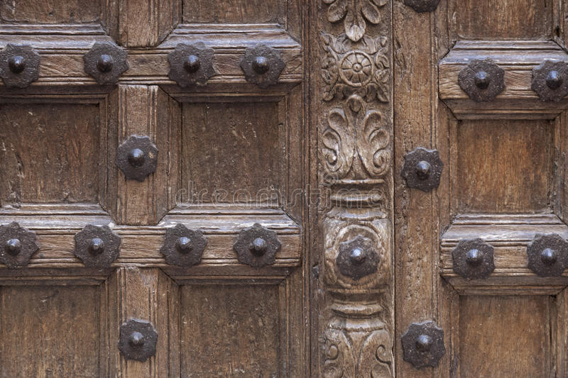 Detail - old ornately carved door stock photo