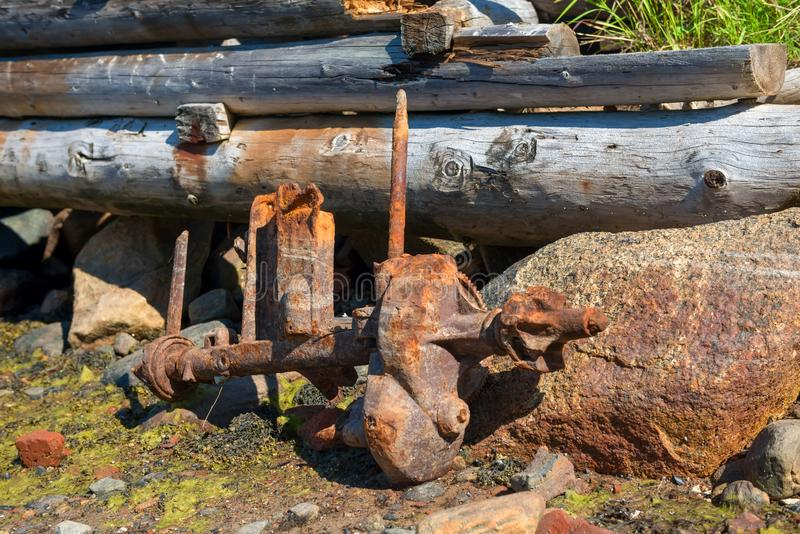 Detail of an old outboard motor. Lying around the marina stock photography