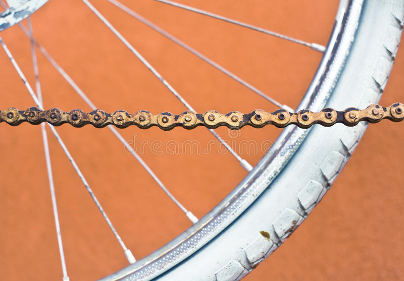 Detail of old road bike - chain, wheel, tire. Detail of old road bike - chain, wheel, tire - on colorful orange background. Shallow depth of field stock photos
