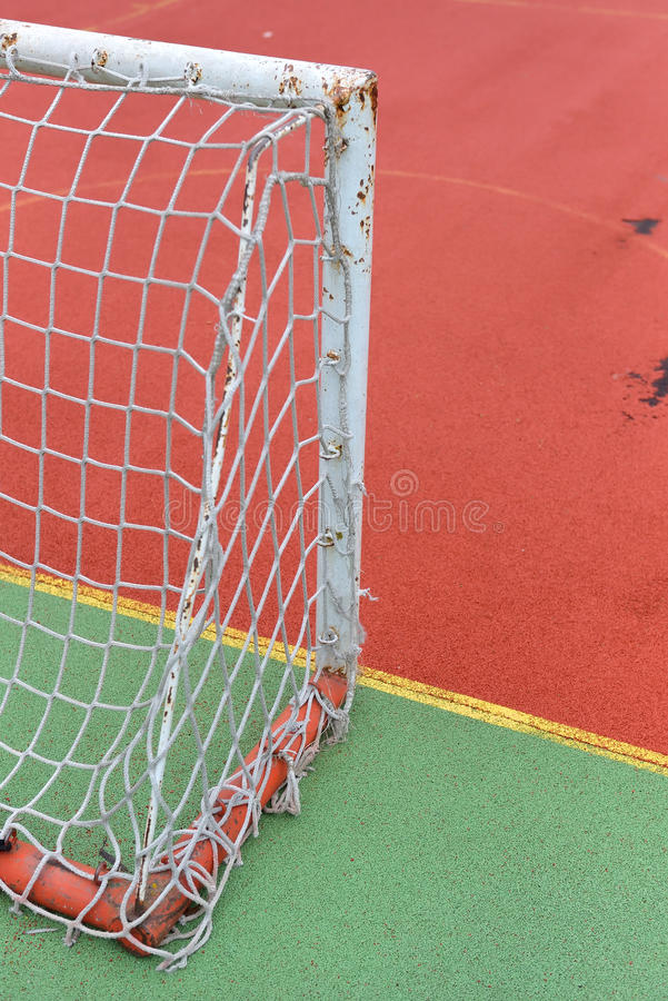 Detail of old and rusty gate of mini football at a soccer field stock photos