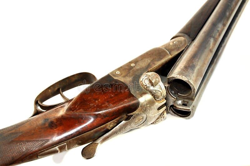 Detail of old shotgun on white. stock photography