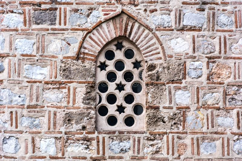 Detail of old stone window and facade on mosque stock photo