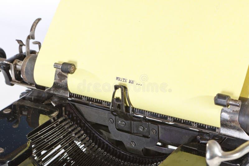Detail of Old Typewriter. Detail of a Yellow Paper in Old Vintage Typewriter royalty free stock images