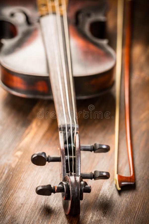 Detail of old violin and bow in vintage style royalty free stock photos