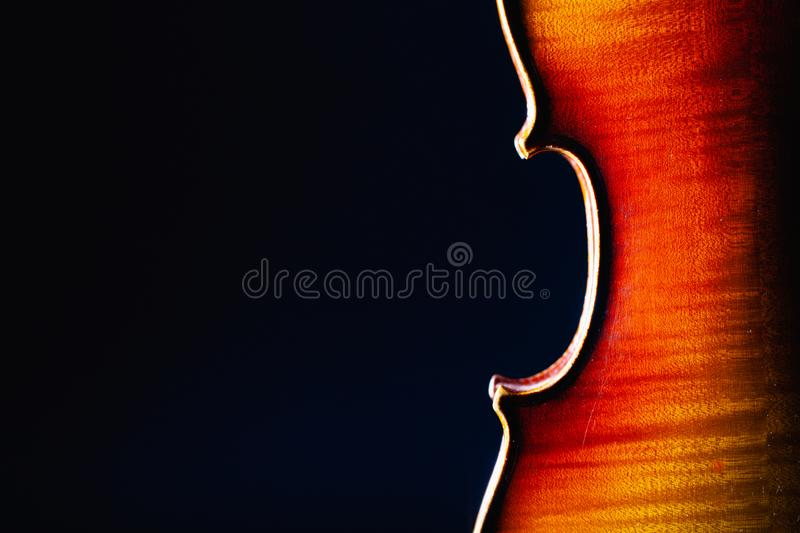 Detail of old violin music instrument of orchestra closeup isolated on black stock photo