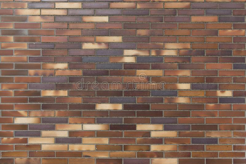 Detail of an old wall of yellow to brownish clinker bricks. As a background royalty free stock photo