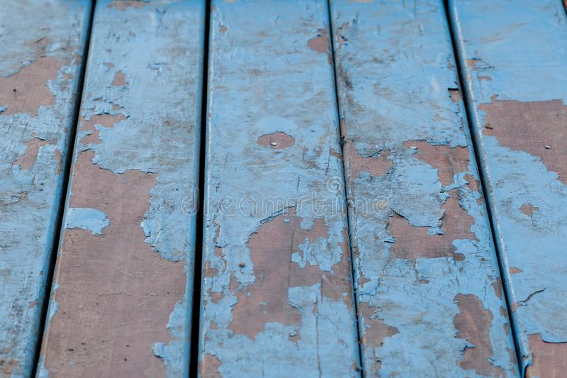 Detail of old wooden boards painted in light blue with several layers of shelled paint.  royalty free stock image