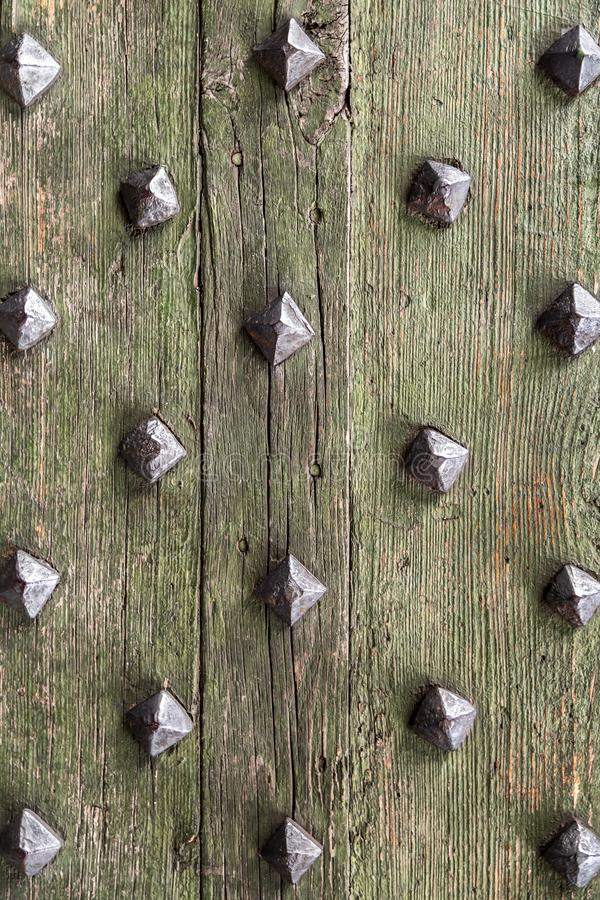 Detail from old wooden door with ancient metal rivets. Texture background, design element stock photos