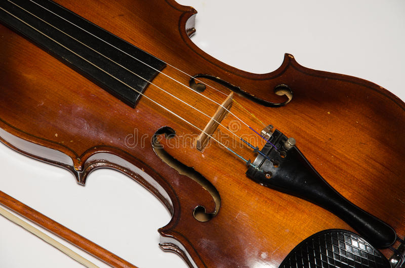 Detail of old wooden violin. Isolated on white background royalty free stock images