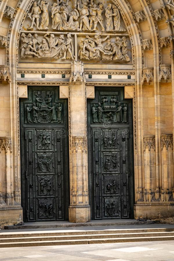 Detail of one door of the Cathedral of Saints Vitus, Wenceslaus and Adalbert  commonly named St. Vitus Cathedral. Detail of one door of the Metropolitan stock images