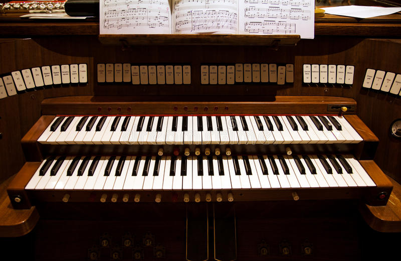 Detail of an organ in a church. Keyboard of an organ in a church royalty free stock photography