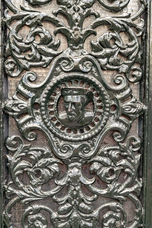 Detail of an ornamented iron door in Amsterdam. In a vertical picture stock photo