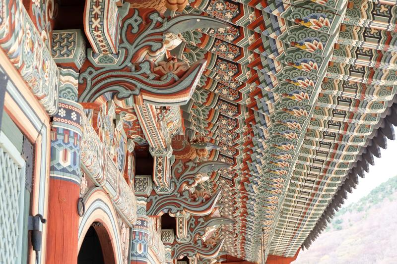 Colorful wooden roof structure in a Korean buddhist temple stock photography