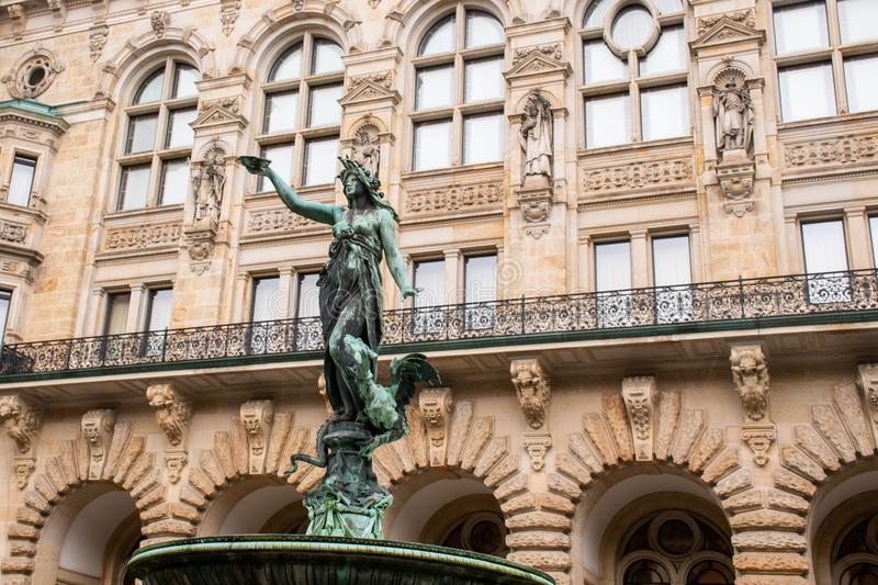Detail of ornate statue of Woman in fountain with large ancient building in the background. Detail of ornate statue of Woman in fountain with large ancient royalty free stock photography