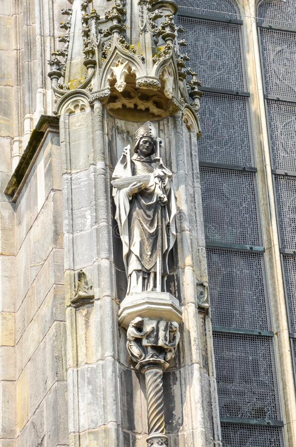 Detail of the outside facade of St. John`s Cathedral in Hertogenbosch, North Brabant, Netherlands. Dutch Gothic architecture,. Largest catholic church in the royalty free stock photos