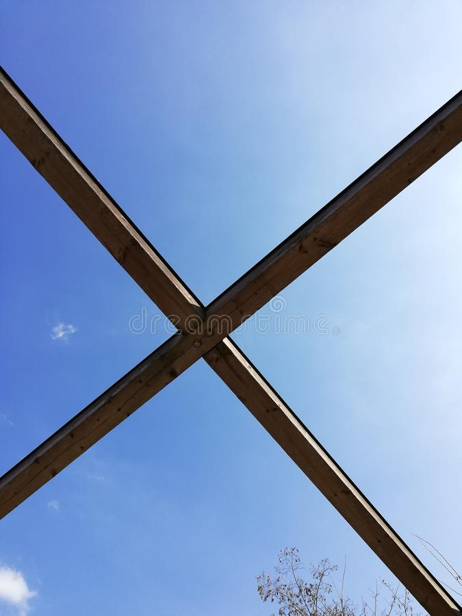 Semicircular detail of wooden bridge and blue sky stock photo
