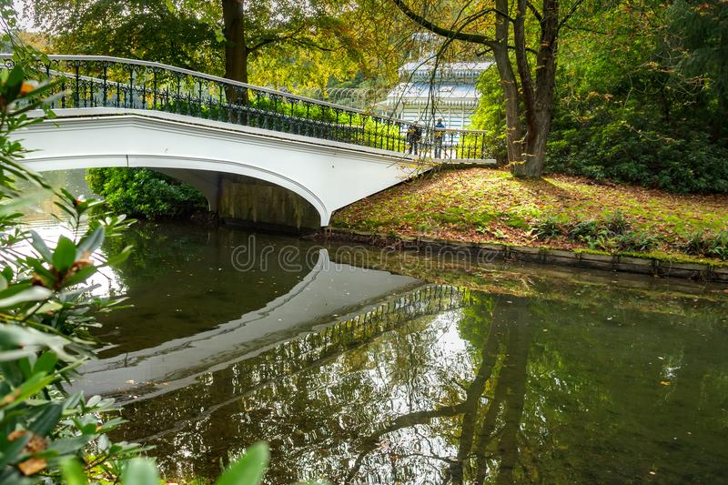 Detail of the Palace Park in Apeldoorn near `t Loo. Decorative white bridge in t `Loo park located in Apeldoorn in the Netherlands. A beautiful autumn landscape royalty free stock images