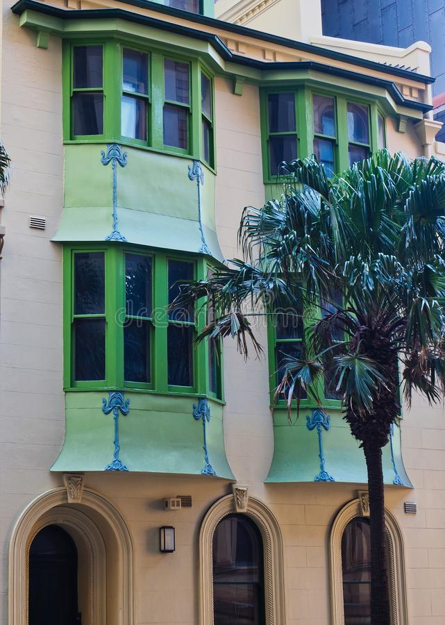 Green Bay Windows on Historic Sydney Houses, Australia. Detail of pale green painted bay windows on historic attached terrace houses in Sydney City, NSW stock photo