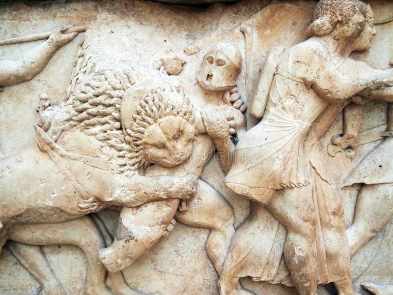 Ancient Greek Bas Relief Marble Sculpture, Delphi Archeological Museum, Greece. Detail of partially restored Ancient Greek bas relief marble sculpture or carving royalty free stock image