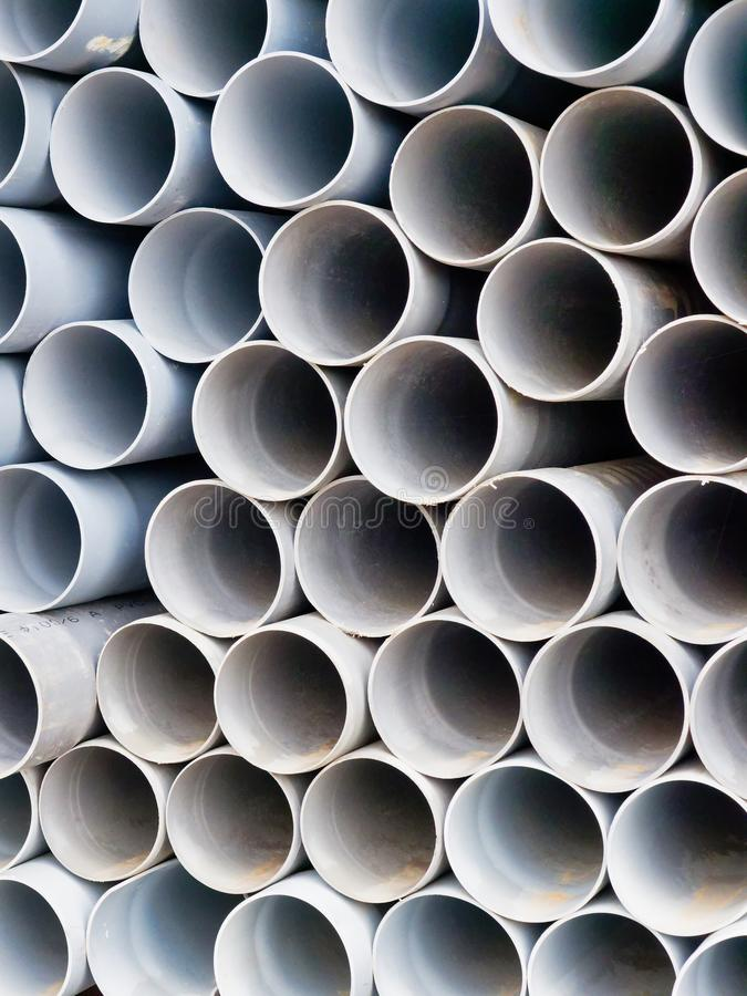 Detail Pattern of Many Stacked Plastic Water Pipes. Detail pattern of many plastic or polyurethane water or sewerage pipes stacked for sale at a building supply royalty free stock images