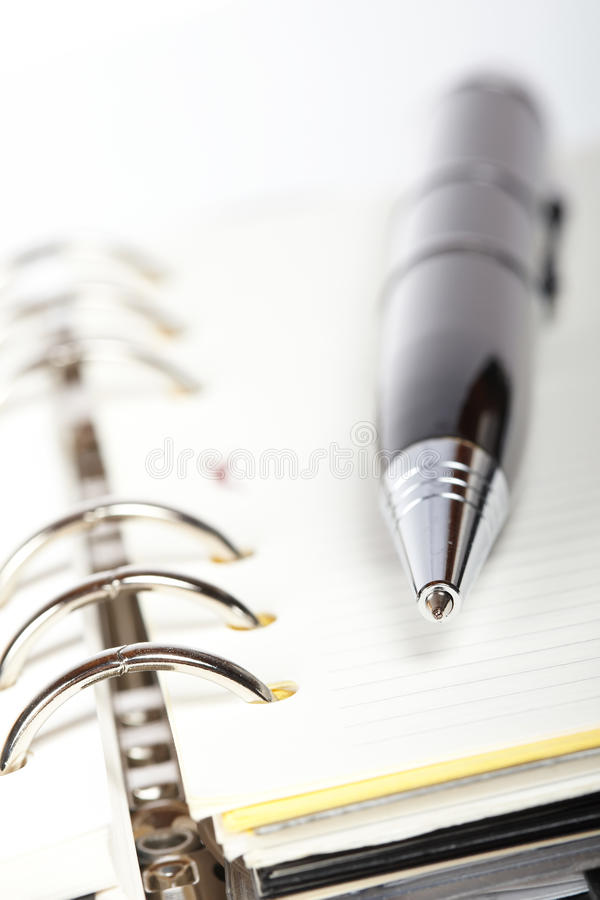 Detail of pen and opened agenda. With very shallow depth of field stock photos