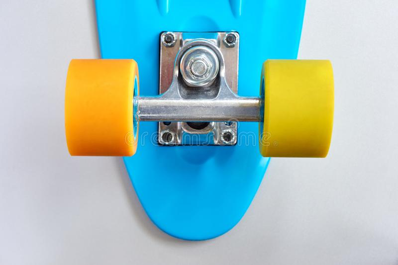 Detail of penny board on grey background stock images