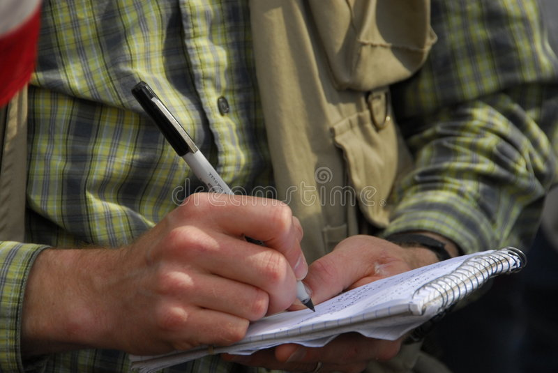 Detail photo of man journalist taking notes royalty free stock photos
