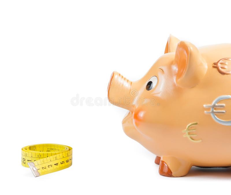 Detail of piggy bank and measure tape, concept for business and save money royalty free stock photos