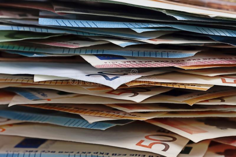Detail of a pile of euro bills stock photography