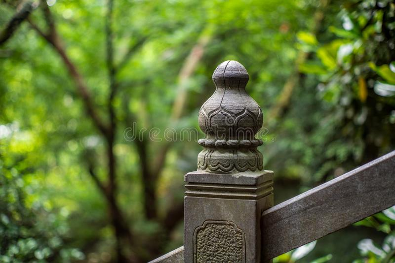 Detail of a pillar sculpture on a stone bridge in a park in Wenzhou in China - 1. Detail of a pillar sculpture on a stone bridge in a park in Wenzhou in China stock image