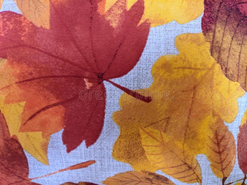 Detail Of A Pillow In An Autumn Leaf Pattern royalty free stock photo