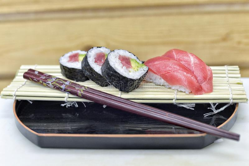 Detail of a plate with sushi and sashimi. stock photo