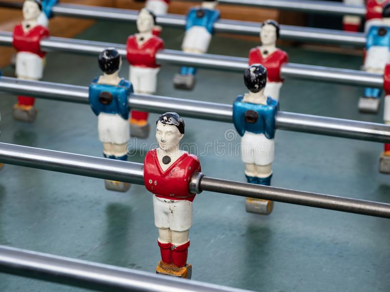Some players on a Mini football game table in close up view stock photos
